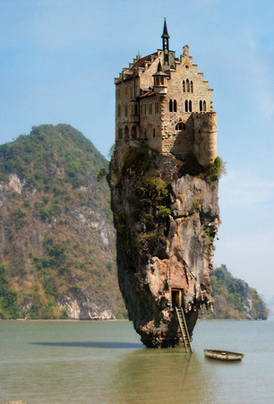 castle on rock in water